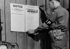 soldier hanging exclusion order sign